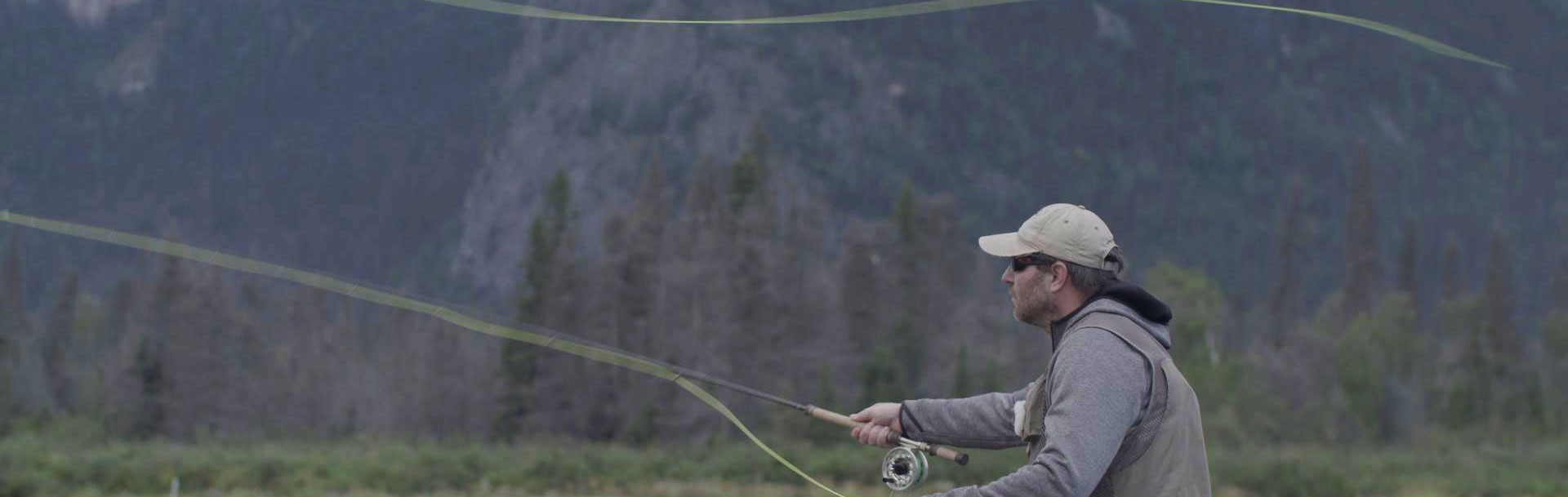 A man casting a fly fishing rod